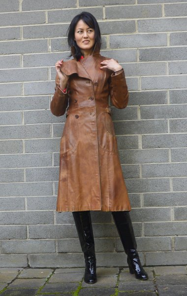 brown leather trench coat with pink mock neck sweater