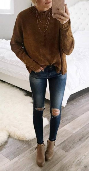 brown mock neck chunky knit sweater with blue ripped skinny jeans
