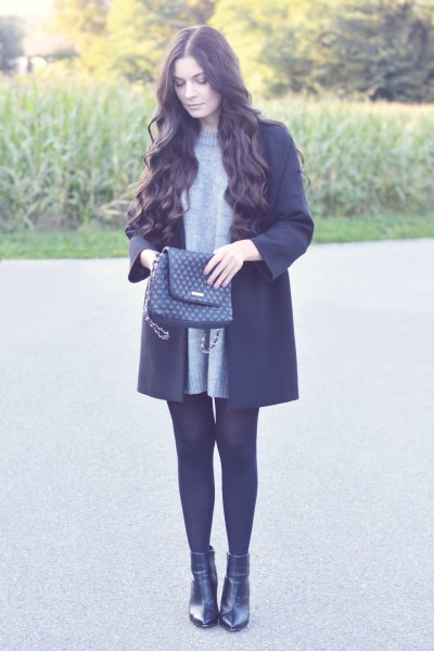 crew neck sweater dress with black wool coat and leather boots