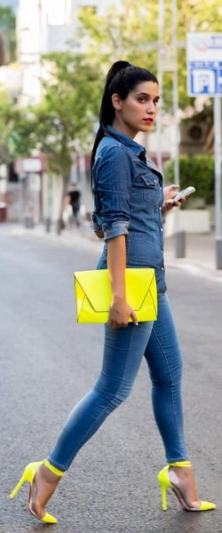dark blue chambray button up shirt with yellow clutch bag and matching high heels