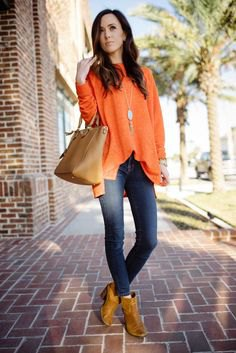 dark orange leather ankle boots with chiffon blouse and jeans