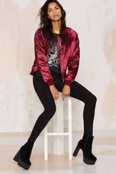 dark red bomber jacket with black print tee and skinny jeans