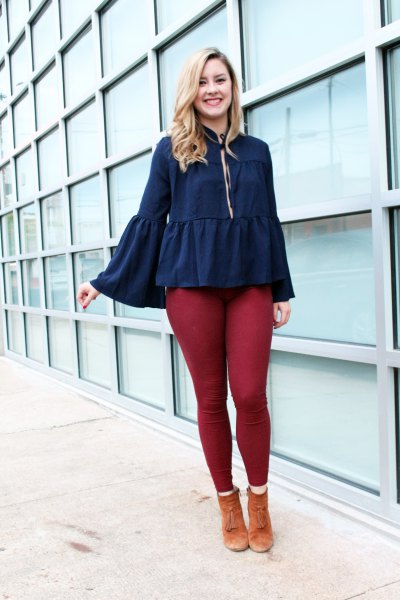 deep blue bell sleeve ruffle blouse with green leggings