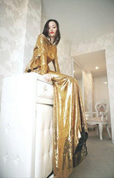 gold long sleeve floor length flowy dress