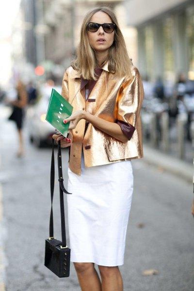 gold metallic blazer jacket with white knee length skirt