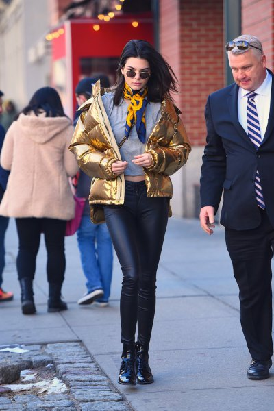 gold metallic down jacket with leather leggings