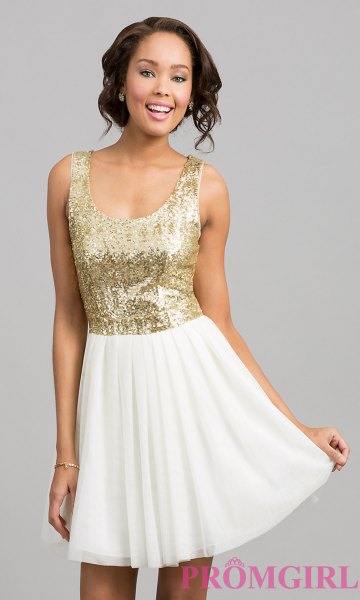 gold scoop neck sequin top with white mini skater skirt