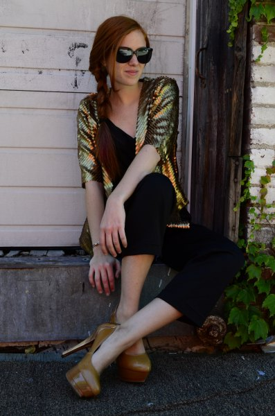 gold sequin jacket with black v neck vest top and matching cropped pants
