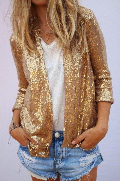 gold sequin jacket with blue mini ripped denim shorts