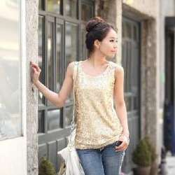 gold sequin tank top with white leather purse