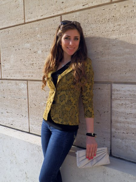golden floral printed blazer with blue jeans
