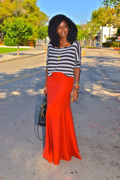 grey and black striped boat neck long sleeve top with orange maxi skirt