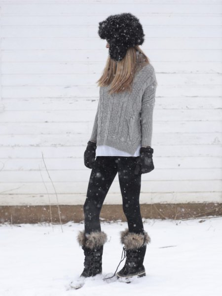 grey cable knit sweater with white button up shirt and faux fur snow boots