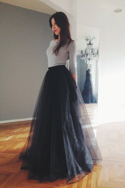 grey form fitting top with black floor length tutu dress