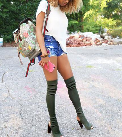 grey heeled boots with white t shirt and blue high rise denim shorts
