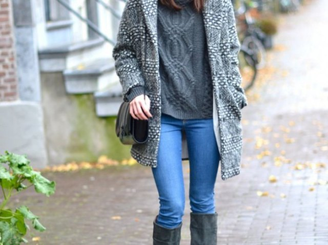 grey long sweater coat with light blue jeans and black knee high boots