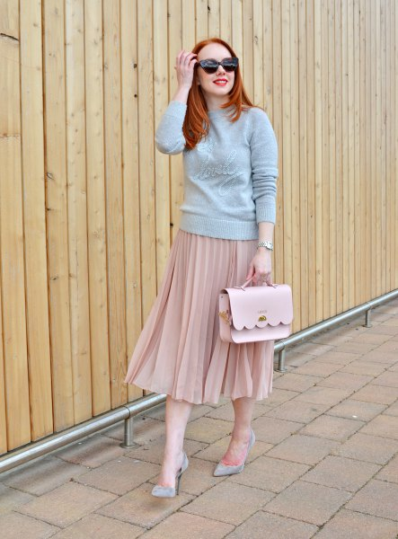 grey mock neck sweater with pink pleated skirt