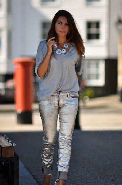 grey v neck half sleeve tee with silver cuffed jeans
