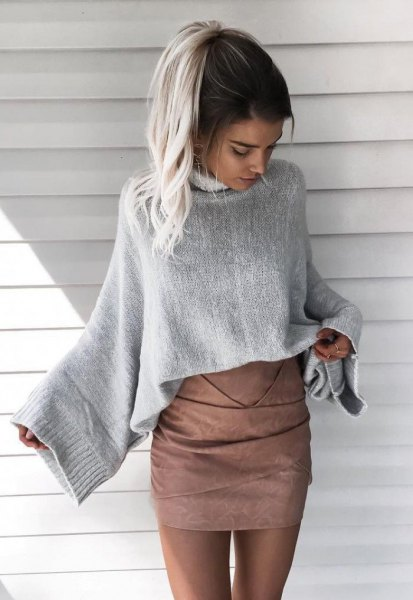 grey wide sleeve knit sweater with matching matte leather skirt