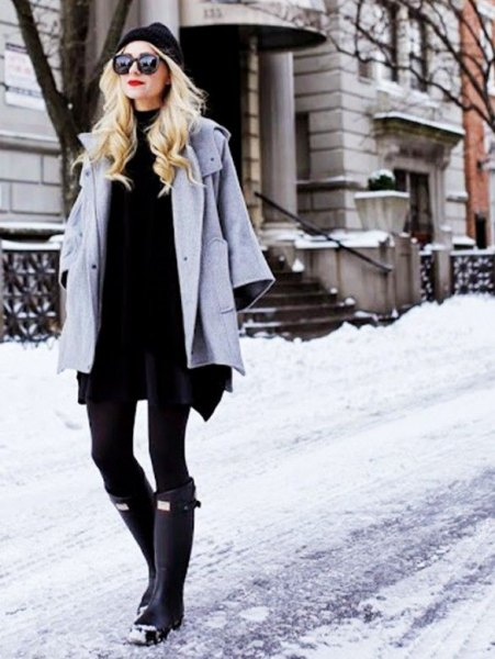 grey wool coat with black shift mini dress and knee high snow boots