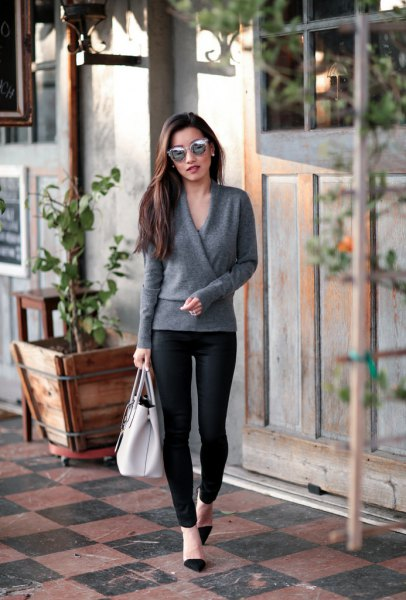 grey wrap sweater with black coated skinny jeans