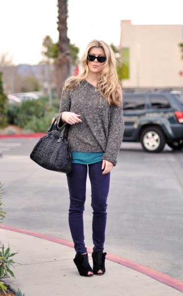 heather grey chunky sweater with purple jeans and suede boots