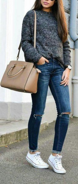 heather grey sweater with blue jeans and pink purse