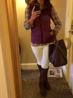 hooded purple puffer vest with plaid shirt and white jeans