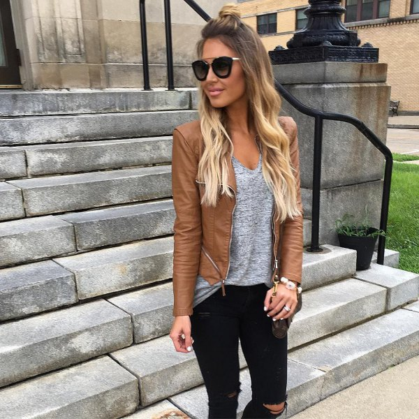 leather jacket with heather grey v neck tank top and ripped jeans