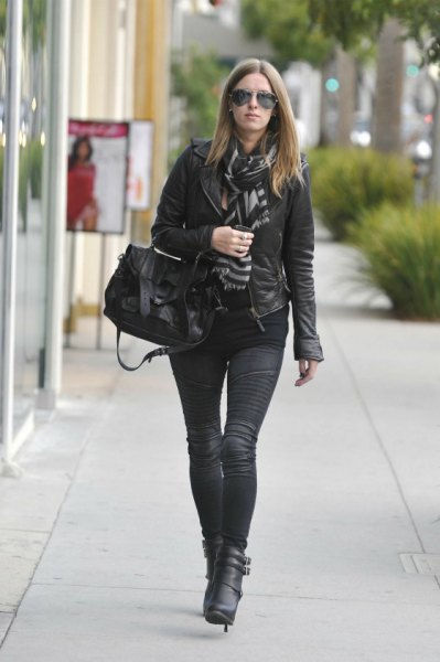 leather jacket with scarf and black moto jeans