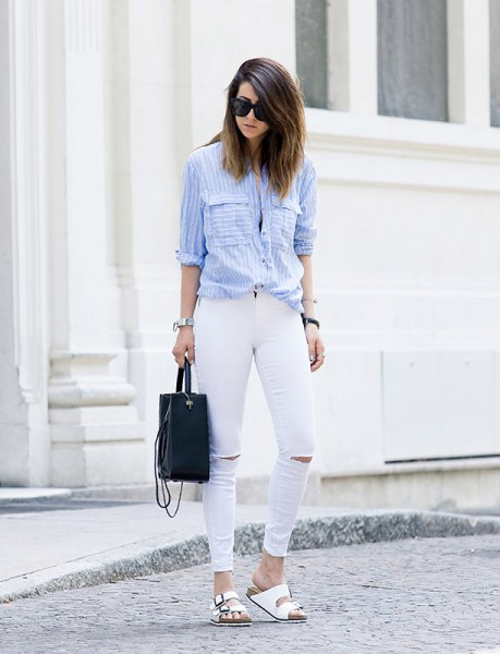 light blue and white striped button up shirt with ripped jeans