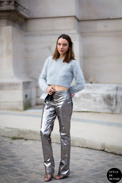 light blue cropped knit sweater with silver pants and sandals