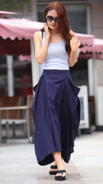 light blue form fitting tank top with navy maxi flared skirt