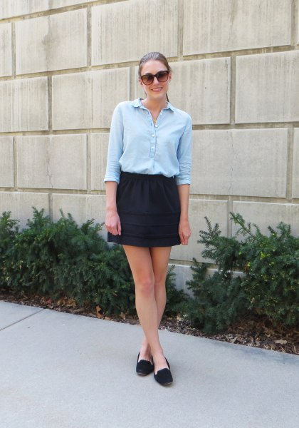 light blue half sleeve blouse with black mini skirt
