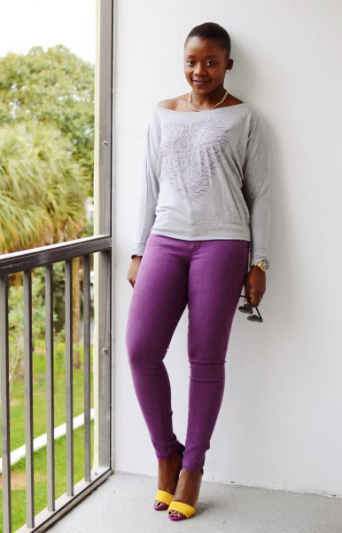 light grey boat neck long sleeve tee with purple jeans