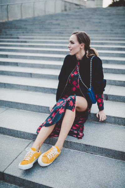 low top sneakers with black and red floral printed midi skirt