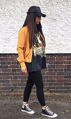mustard yellow bomber jacket with black oversized print tee