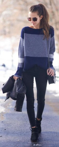 navy and light blue color block sweater with black jeans