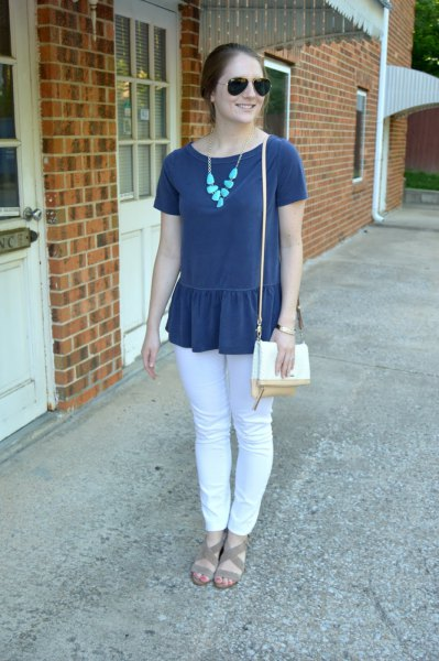 navy blue peplum short sleeve top with white jeans