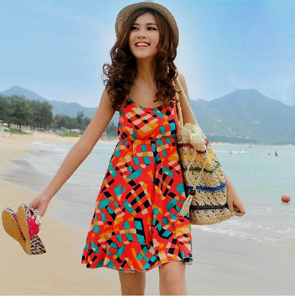 orange and teal blue printed sundress with straw hat