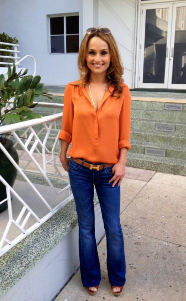 orange button up chiffon shirt with blue flared jeans
