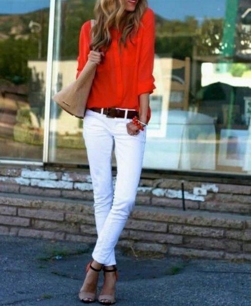 orange shirt with white skinny jeans
