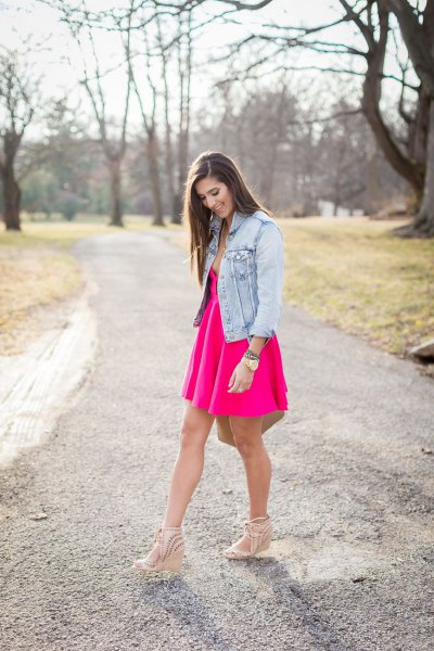 pink deep v neck skater dress with blue denim jacket