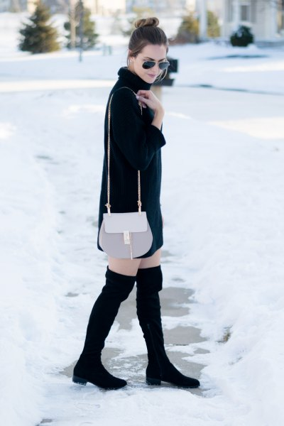 pink nifty purse and black thigh high boots