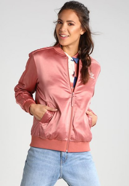 pink sports jacket with light blue boyfriend jeans