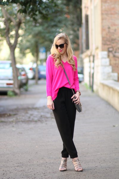 pink v neck sweater with black chinos