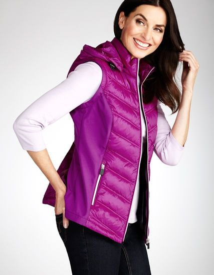pinkish hooded vest with white top and black jeans