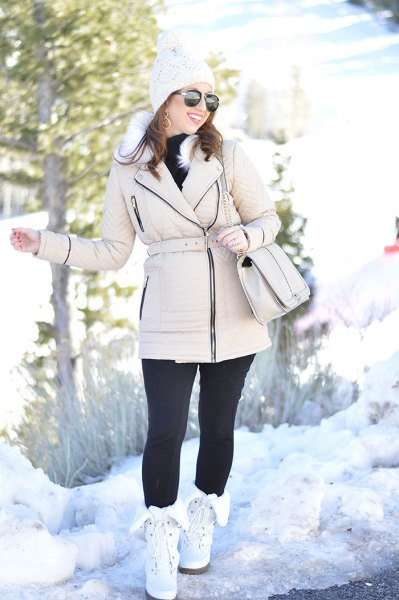 puffer zip jacket with black leggings and white snow boots