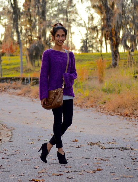 purple boat neck sweater with black cropped skinny jeans