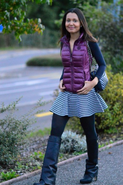 purple down vest with long sleeve form fitting tee and checker tunic